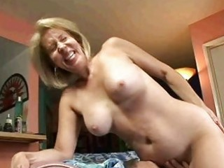 Blonde granny sucks on cock then gets her old