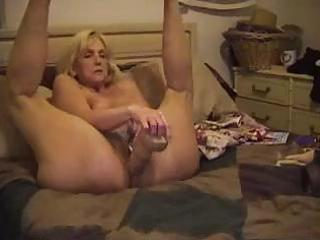 aged blondie sticks a monstrous sex toy and her
