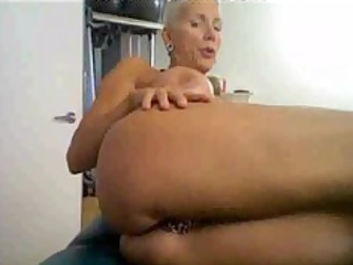 horny older on cam, with many rings on her