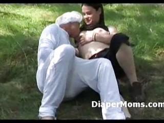 brunette hair mom breast feeds adult baby in