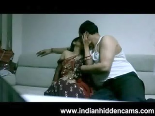 aged indian couple in lounge after party seducing