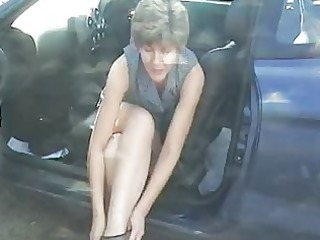 sara changing in the car