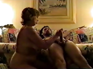 Big tits mature uses hands, mouth, tits on young