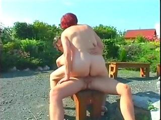 fat older redhead drilled outdoors
