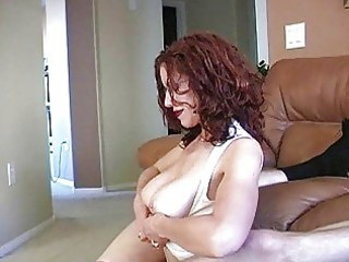 Teasing redhead milf with glasses and huge boobs