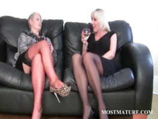 golden-haired lesbian rubs her older snatch