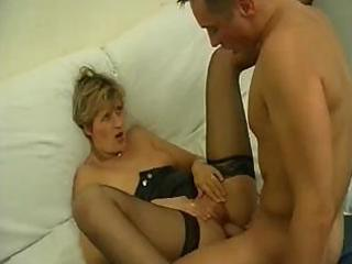 Blonde mature is horny and sucks on a cock before