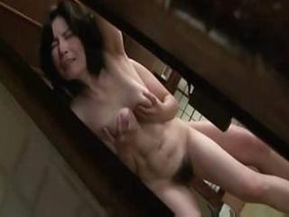 older japanese woman receives lathered up and