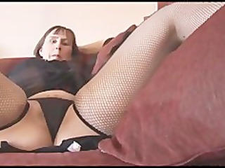 busty older brunette with hairy pussy undresses