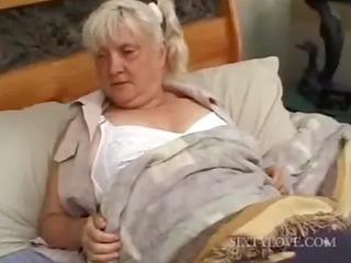 Mature blondie gets full body massaged