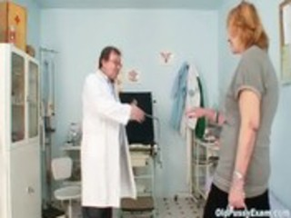 redhead granny dirty slit stretching in gyn clinic