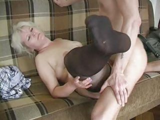 mature golden-haired in stockings copulates the