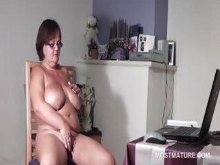 big titted mature babe satisfying her