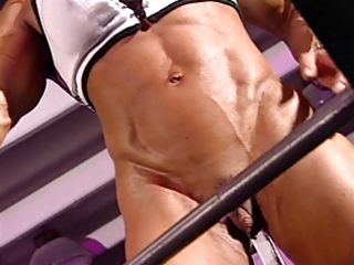 Bodybuilder mature in training center with high