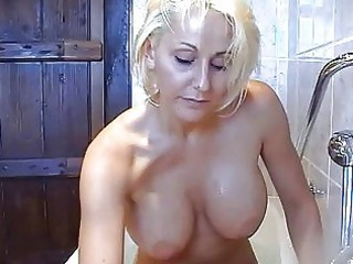 Bootylicious busty blonde momma plays with