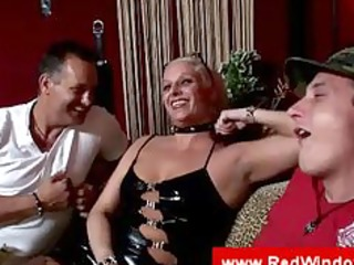 older blonde hooker sucks a cock