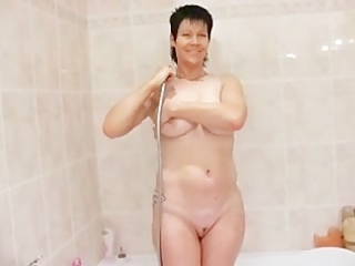 older chick toying in bathtub