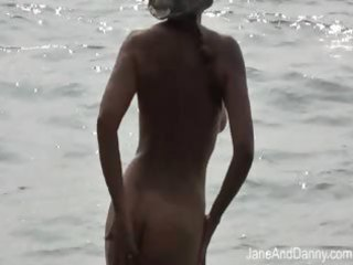 Voyeur fucks hot milf on the beach