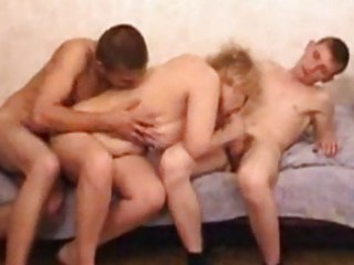 blond aged cougar teaching 8 guys