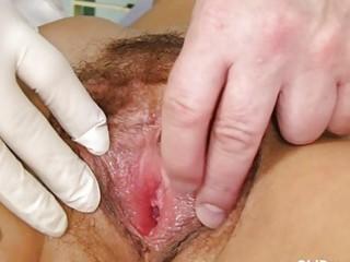 fuckable brunette granny gets her bushy examined