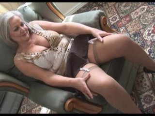handsome breasty granny in stockings stripping
