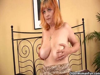 redheaded granny with big scoops sucks dong and