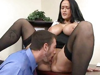 Mature busty brunette fucks businessman in office