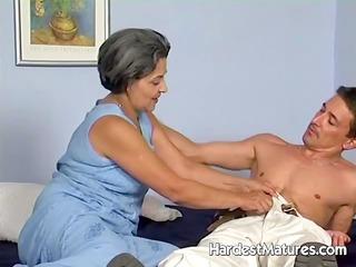 old lady engulfing pecker whilst fingering