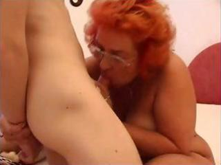 horny redhead granny blows rod and gets her old