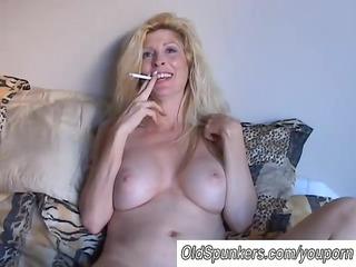 glamorous blonde mother i enjoys a smoke break