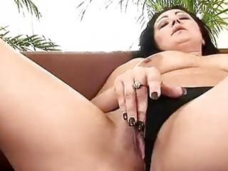 mature grace uses a vibrator on herself