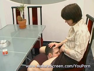 sex on kitchen table with palatable mature lady