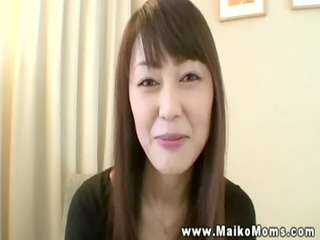 oriental business lady lets boss rub her