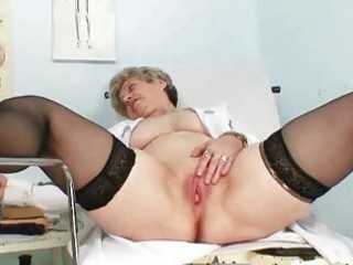 breasty granny in uniform stretching her older