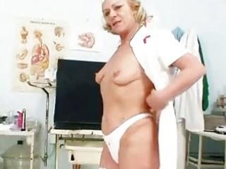 blond granny nurse using gyno fur pie spreader