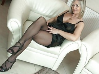 sexy golden-haired milf in pantyhose uncovers her