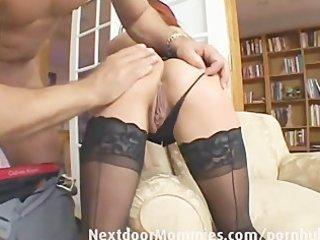 redhead mamma swallows cum from a large jock