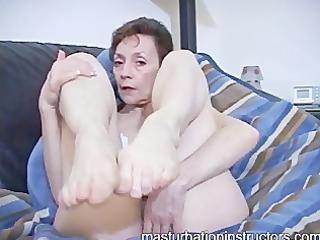 oldie mistress in bikini displays her feet for a