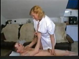 chunky blond granny nurse gives her patient head