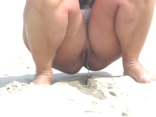 pissing on the beach