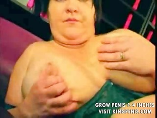large corpulent breasty lady uses a fake penis