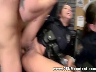 two female cops in uniform acquire their slits