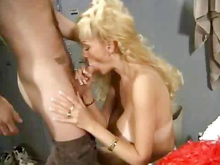 middle-aged cheerleader with gigantic bust still