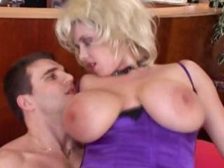 hot, breasty older blond receives a juvenile dong