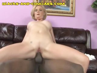blonde cougar goes for a large dark cock and