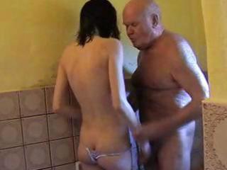 juvenile dark brown helps older man take a shower