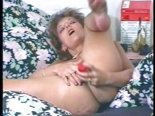 perverted milf masturbates and uses large toy