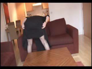 breasty older brunette with shaggy slit undresses