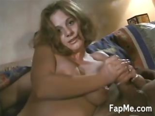 fascinating milf rubs a hard white penis