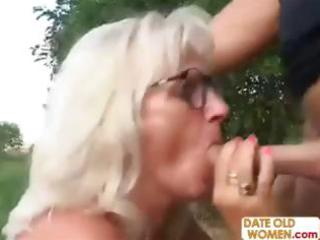 golden-haired romanian granny chomps on his dick